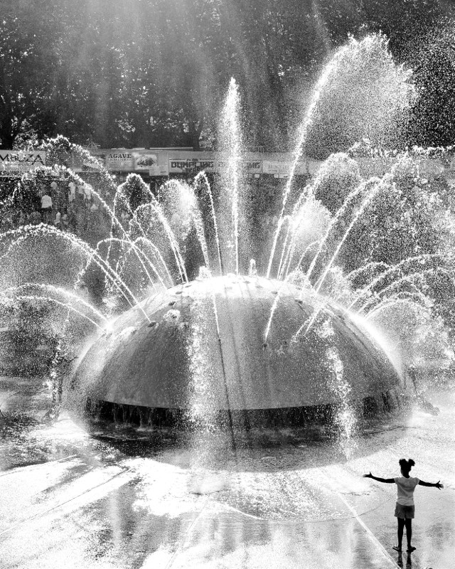 Celebration     #park #blackandwhite #silhouette #joy #children #travel #seattle #fountain #laughter #light #shadow #water #splash #monochrome