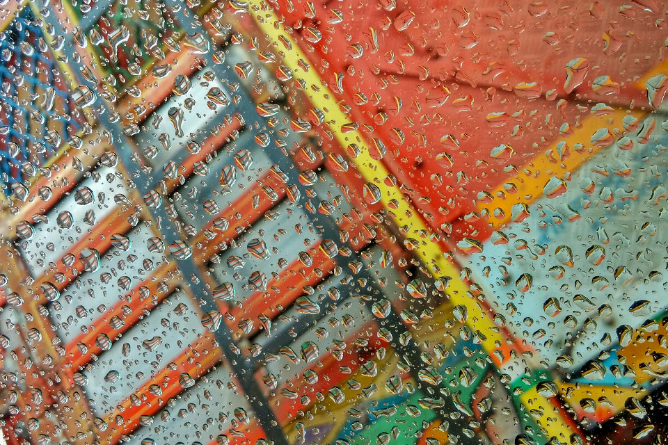 #ViewFromMyWindow  It was raining & A colourful turck besides my car's window..